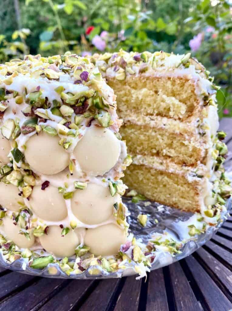 a slice of white chocolate and pistachio cake